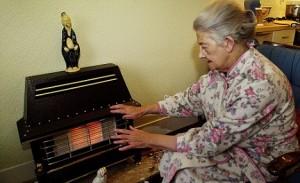 Old lady keeps warm